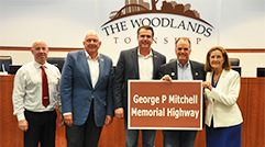 Township Board with George Mitchell Memorial Highway Sign