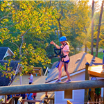 Texas TreeVentures Participant Balancing on Catwalk at Sunset
